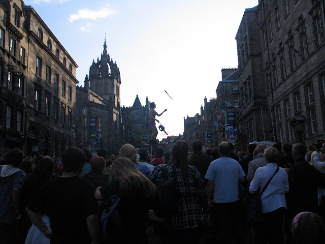 Chainsaw juggling street show in the Royal Mile