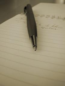 Bloco de Notas e Caneta