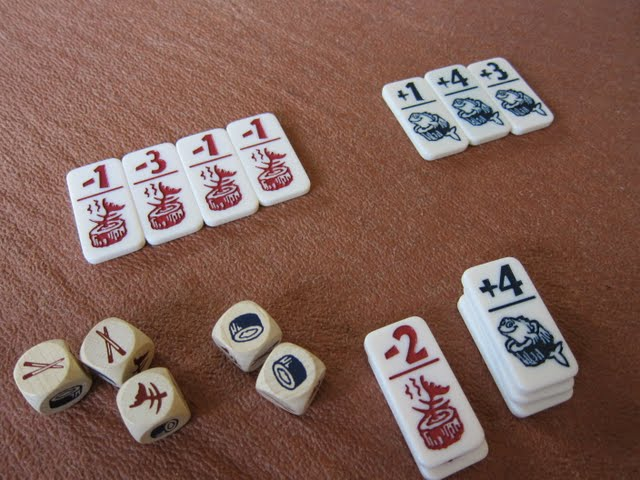 Playing pieces and dice from Sushizock-im-Gockelwok