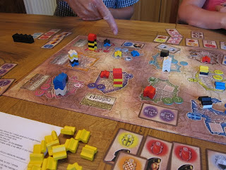 The board late in the game with a strategic hand pointing out the towers