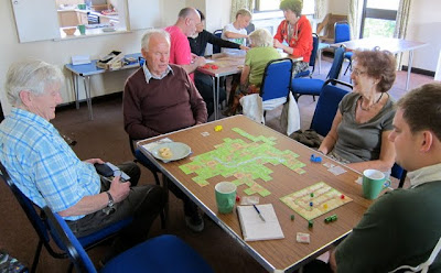 The group playing Carcassonne survey the landscape they created