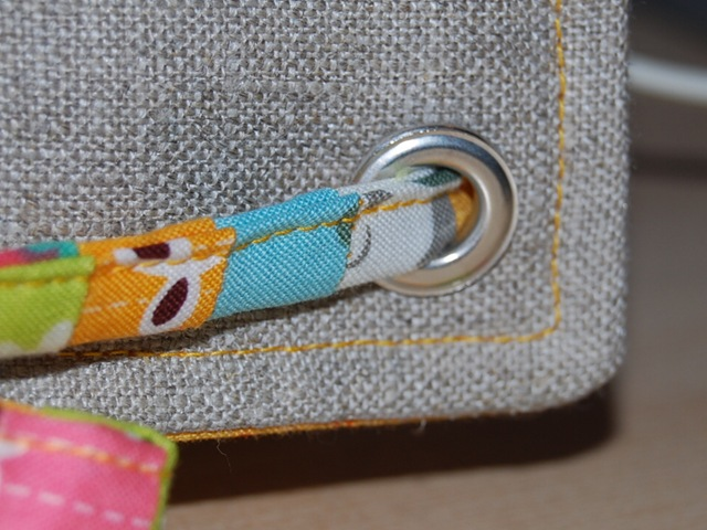 Sewing machine cover eyelet