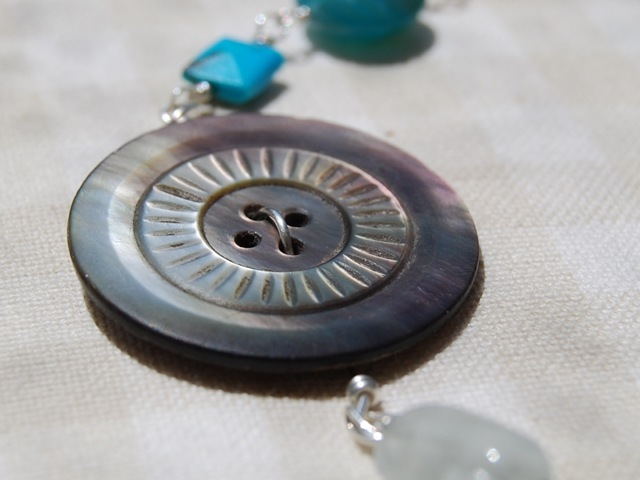 Necklace button close-up