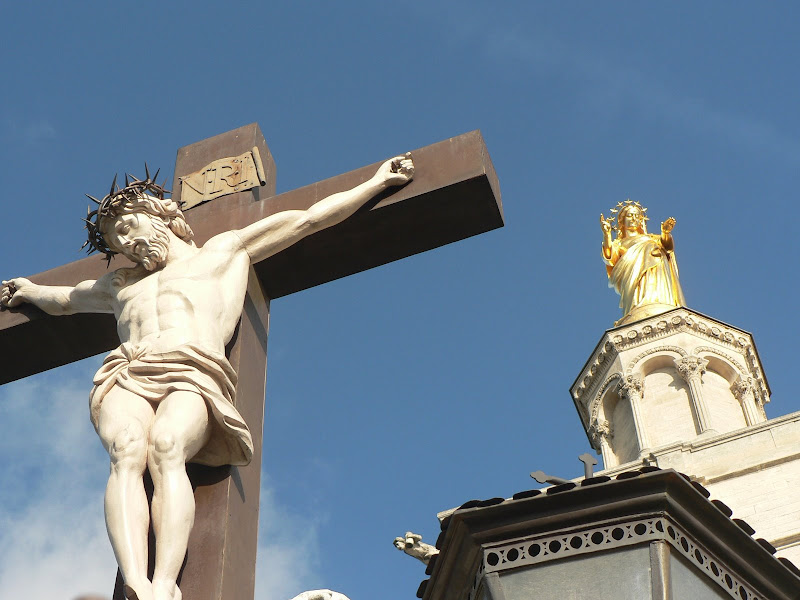 Jesus on the cross and Mary statues