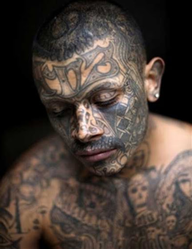 7-year-old son a gang tattoo at the boy's insistence — but immediately