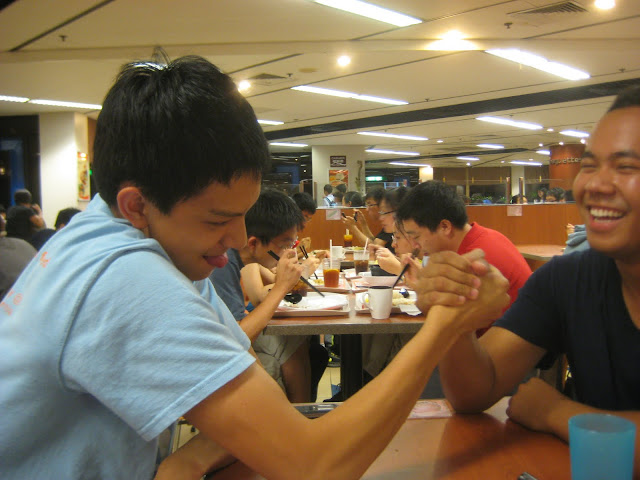 Carson and Chanrith arm wrestling