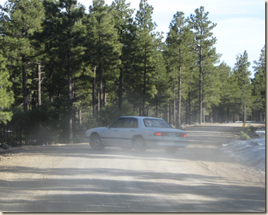 car turning in dust cropped
