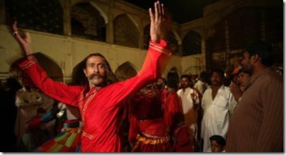 A Sufi pilgrim dances at the shrine of Lal Shahbaz Qalandar, in Sehwan Sharif, Pakistan, in 2006. Photo by Aaron Huey.