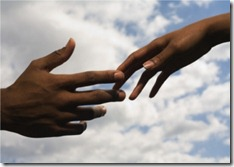 hands-of-couple-reaching-for-each-other-resize