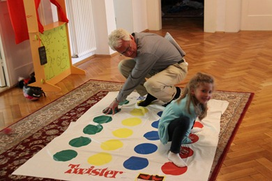 Papa playing twister with the girls in our hall.