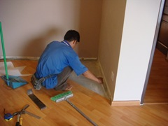 Replacing damaged laminated floor panels in the master bedroom