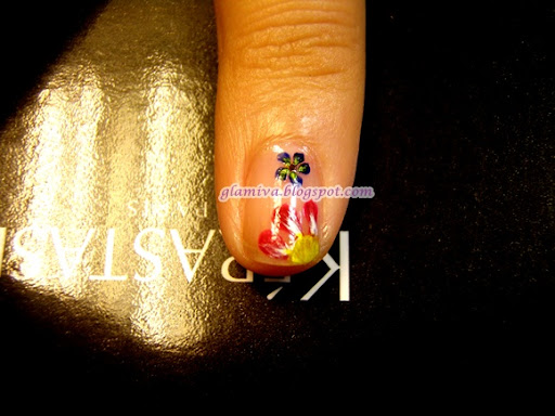 red yellow and blue flowers nail art design with butterfly wings