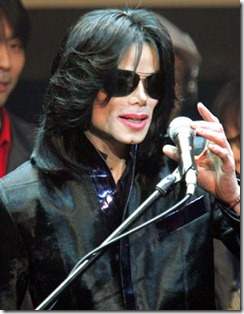 "**FILE** Michael Jackson delivers his speech to fans during an event ""Fan Appreciation Day"" in Tokyo on March 9, 2007. Jackson is ""a little bit under the weather,"" but has not sought hospital treatment, his spokeswoman said Thursday, March 29, 2007. (AP Photo/Itsuo Inouye)"