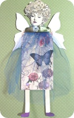 art decoupaged paper doll