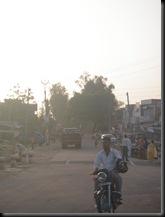 Man Holding Helmet