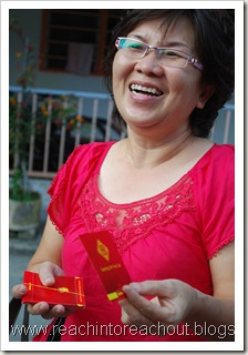 aunt giving out ang pow's