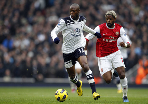 Tottenham Hotspur's William Gallas competes with his old Arsenal's friend Alexandre Song