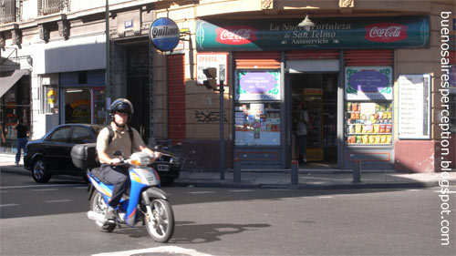 Motorbike is passing by one of these lovely, oldfashioned supermarkets near Parque Lezama in the San Telmo neighborhood in Buenos Aires, Argentina