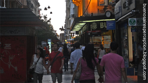 People Strolling along the most Famous Pedestrian Zone in Buenos Aires: The Shopping Street