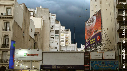 Facing the looming, dark sky of an thunderstorm in the streets of Buenos Aires, Argentina