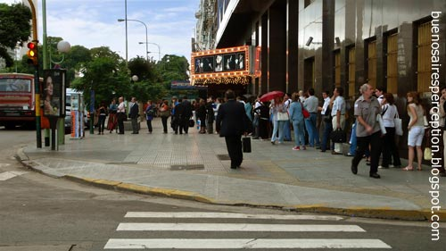 Wasting time in the waiting line for a bus. Seen in San Nicolás, Buenos Aires