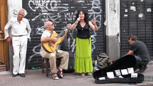 """Singer performing """"Acuarela del Río"""" at the Fería de San Pedro Telmo in Buenos Aires, Argentina"""