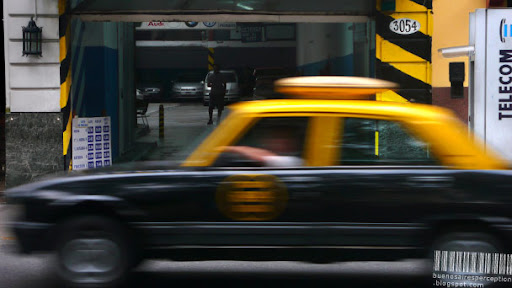 Speedy Radio Taxi Rushing Through the Streets of Buenos Aires, Argentina