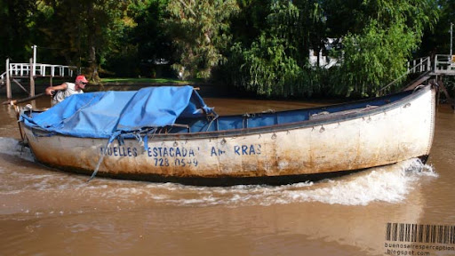 Man Maneuvering his Motor Boat in the Paraná Delta in Tigre near Buenos Aires, Argentina