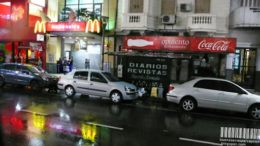 Colorful Reflection of the Exterior Lighting of a McDonald's Restaurant after the Rain in Buenos Aires, Argentina