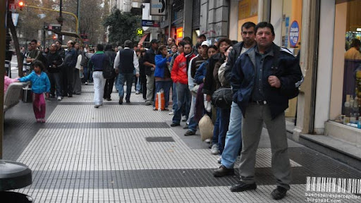 Long Line at a Bus Stop in Avenida de Mayo in Buenos Aires, Argentina