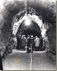 Leaders inspect a tunnel during construction