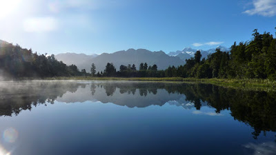 Mist rising over Lake Matheson