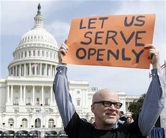 Protester holds sign reading 'Let us serve openly'