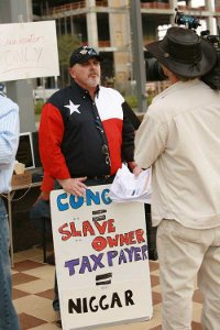 Teabagger with misspelled, racist sign