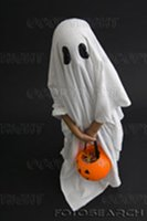 Kid wearing a bedsheet ghost costume