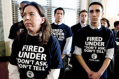 Former military personnel wearing 'Fired under 'don't ask, don't tell' tshirts