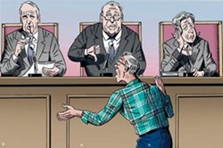Man argues in front of a panel