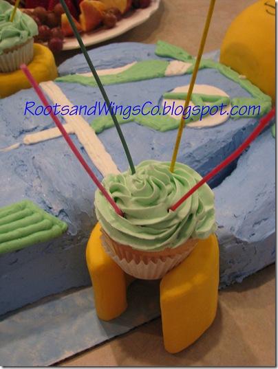 Lego Agent cake holding cupcakes