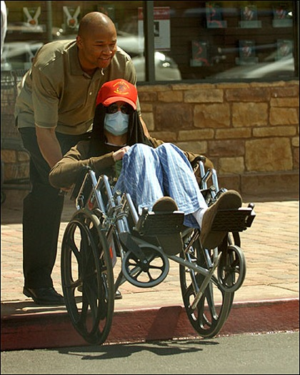 ©NATIONAL PHOTO GROUP<br />Michael Jackson is pushed in a wheelchair while shopping with his children at a Las Vegas bookstore.<br />Job: 070708J1<br />Exclusive July 7th, 2008 Las Vegas, NV<br />nationalphotogroup.com