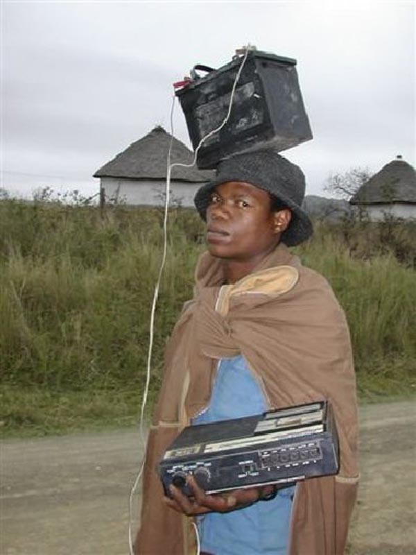 Weekend Fun - Funny things of Africa - Man playing radio with batteries on head