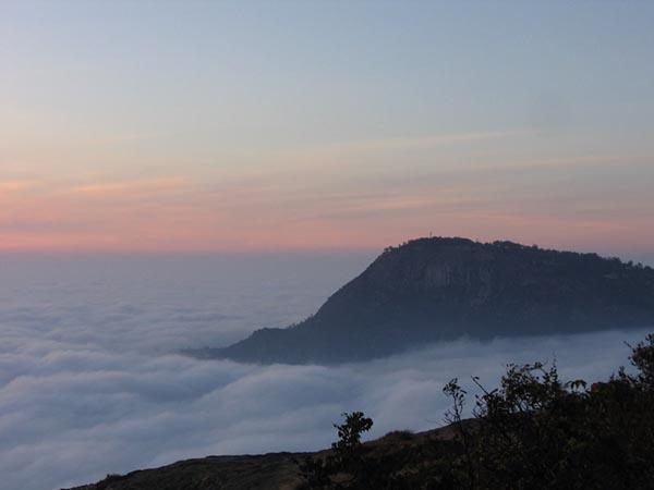 Kalavaarahalli betta [skanda giri] - A peak peeking out from the clouds