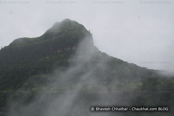 Peak of Tamhini ghat rising above the clouds of monsoon