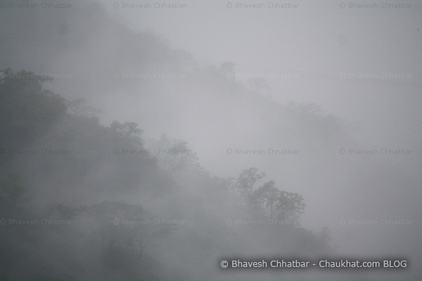 Pristine forest with a blanket of monsoon clouds