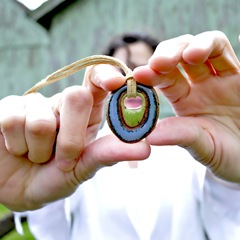 eclectic geometric stoneware hippie pendant model shot by glazedOver Pottery blue with green center