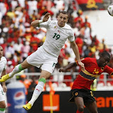 Algeria's Hassan Yebda (C) is challenged by Djalma of Angola (R) while Algeria's Yazid Mansouri looks on during their African Nations Cup soccer match in Luanda, January 18, 2010. REUTERS/Mike Hutchings (ANGOLA - Tags: SPORT SOCCER)