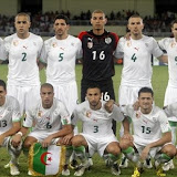Algeria's team poses at the beginning of their African Cup of Nations quarterfinal soccer match against Ivory Coast, in Cabinda, Angola, Sunday, Jan. 24, 2010. Top row, from left: Hassen Yebda, Madjid Bougherra, Rafik Halliche, Faouzi Chaouchi, Anthar Yahia, Abdelkader Ghezzal, bottom: Karim Matmour, Yazid Mansouri, Nadir Belhadj, Karim Ziani, Mourad Meghni. (AP Photo/Darko Bandic)