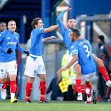Portsmouth's Nadir Belhadj (top right) celebrates scoring his sides first goal with his teammates