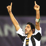 Nacional's Rafik Halliche celebrates after scoring 2-2 against Werder Bremen during their UEFA's Europa League Group L <a href='http://football.endz.co.cc/'>football</a> match at Madeira Stadium in Funchal, Madeira Island, on September 17, 2009. AFP PHOTO/ FRANCISCO LEONG (Photo credit should read FRANCISCO LEONG/AFP/Getty Images)????????