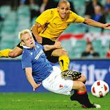 Rafic Djebbour (top) from AEK Athens FC crashes into Steven Naismith (below) from Rangers FC, as he attempts an unsuccessful shot on goal during the Sydney 2010 Festival of Football on July 31, 2010. AEK Athens won 1-0. RESTRICTED TO EDITORIAL USE NO ADVERTISING USE NO PROMOTIONAL USE NO MERCHANDISING USE AFP Photo / Greg WOOD̆̃̄