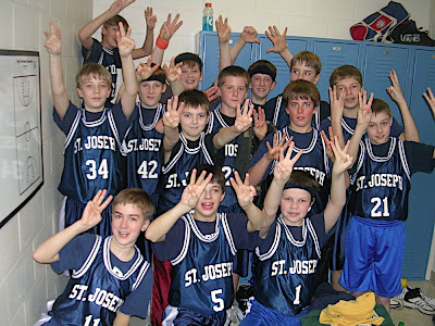 "6th Grade basketball team holds up ""6"""